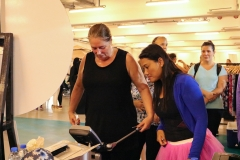 Participants getting a body composition analysis by Daman